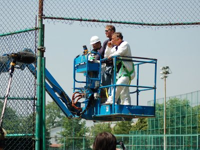 City workmen on the hydraulic lift used to dismantle wild Quaker Parrot nests in the Bronx, NY